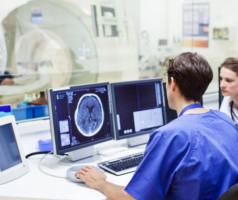 Healthcare workers with MRI imaging